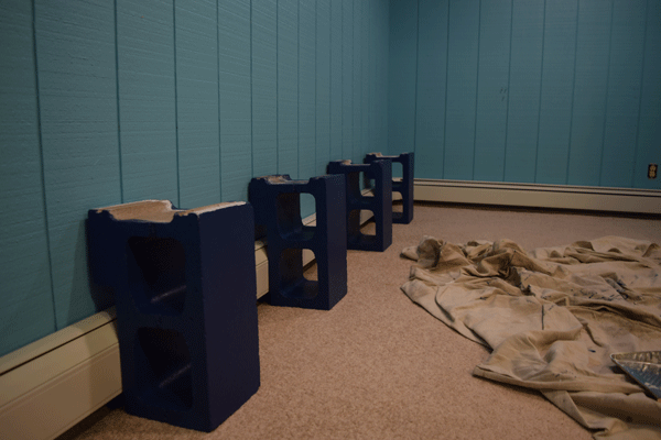 I used the same blue for the cement blocks that will support shelves for books.