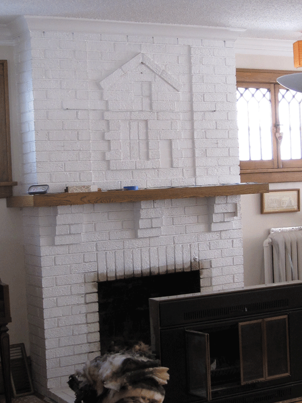 Removing the white paint on the fireplace was not an option.