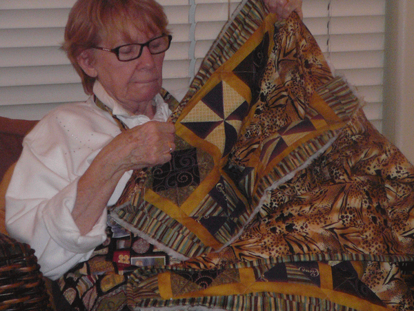My mom sewing the back/front/batting together.