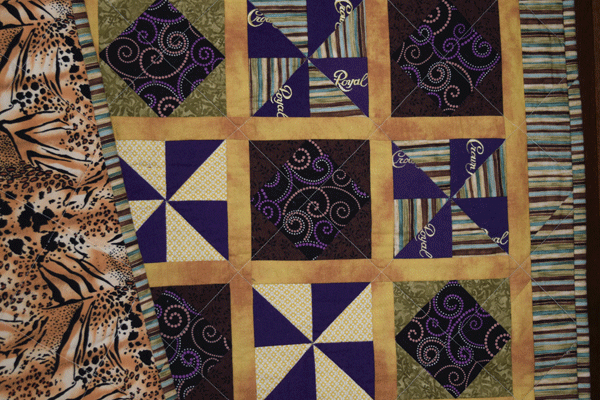 Quilt with Crown Royal bags.
