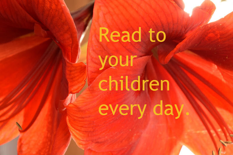 Text: Read to your Children Every Day with red flowers in the background.